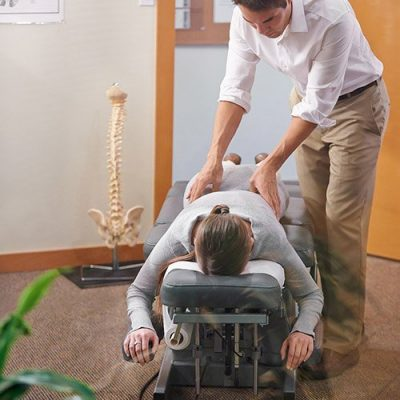 patient on chiropractic table getting adjustment