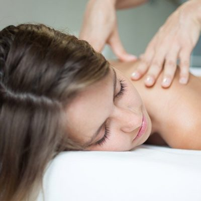patient recovering from surgery getting therapeutic massage
